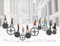People over machine gear wheel in the city. Stock Image