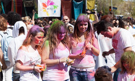 People with paint pigments at  Festival   Holi Barcelona Royalty Free Stock Image