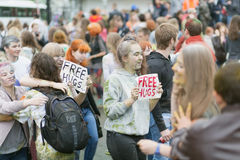 People in the paint and with signs Free Hugs Royalty Free Stock Photo