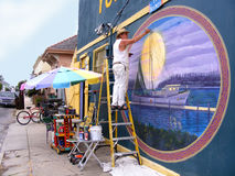 People, Painter Painting Outdoor Wall Mural. People, Painter Painting a Outdoor Wall Mural Outdoors Stock Photo
