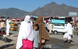 People in Pakistan. ISLAMABAD. November 5th 2011. Busy streets in Mingora the main town of Swat Valley, Northern Pakistan Royalty Free Stock Image