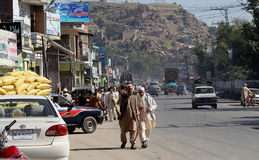 People in Pakistan - a daily life. Busy road in Mingora town the main town in Swat Valley, Northern Pakistan Stock Images
