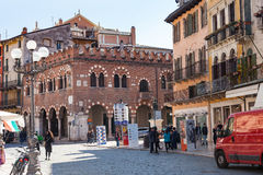People and palaces on Piazza delle Erbe in Verona Royalty Free Stock Image
