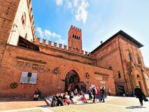People at Palazzo Re Enzo on Piazza del Nettuno Bologna. Bologna, Italy - October 21, 2016: People at Palazzo Re Enzo on Piazza del Nettuno Square in Bologna royalty free stock image
