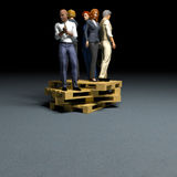 People on pallet. Workers treated as commodity concept Royalty Free Stock Photos