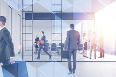 People in panoramic office, triangles royalty free stock photography
