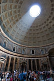 People in the Pantheon in Rome. Interior of the Pantheon, know today as the Roman-Catholic Church of St. Mary and the Martyrs, showing the Dome with its opening stock image