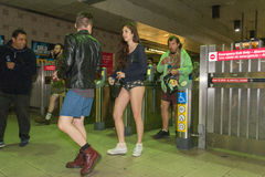 People without pants arriving at the metro station in the Royalty Free Stock Photography