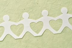 People paper chain - Love and ecology concept. People paper chain - Love, unity and ecology concept Royalty Free Stock Images