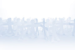 People Paper Cut Chain as Crowd or Teamwork Concept Royalty Free Stock Image