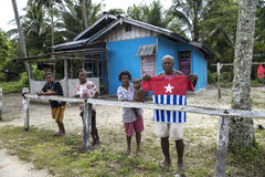 People of Papua West Guinea showing flag Stock Images