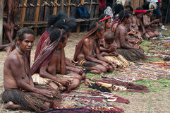 People of Papuan tribal sell traditional souvenirs Royalty Free Stock Images