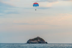 People in Parachute Near Body of Water during Daytime Royalty Free Stock Photography