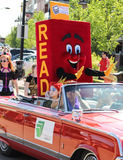 People in parade. Parade costumes  outfits mascots hockey ballons floats outdoors Canada day sunshine book read library Stock Images