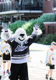 People in parade. Parade costumes  outfits mascots hockey ballons floats outdoors Canada day sunshine book read library edmonton rush mascot Royalty Free Stock Image