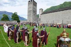 People during a parade of medieval characters on Castelgrande ca Royalty Free Stock Photo