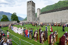 People during a parade of medieval characters on Castelgrande ca Royalty Free Stock Images