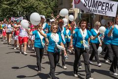 People parading at the Sokol festival in the streets of Prague. PRAGUE, CZECH REPUBLIC - JULY 1, 2018: People parading at Sokolsky Slet, a once-every-six-years Royalty Free Stock Image