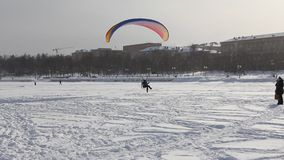 People are paragliding on the lake. Royalty Free Stock Image