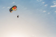 People parasailing over the sea Stock Photo