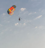 People parasailing over the sea Stock Photography