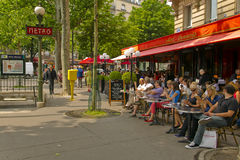 Parisian people sitting at the terrace cafe brasserie restaurant in Paris Royalty Free Stock Image
