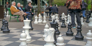 People in the park playing huge chess Stock Photo