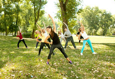 People in the park stretching Stock Images