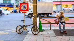 People parking bicycle at Ameya Yokocho the famous shopping area of Ueno District, Tokyo. Royalty Free Stock Photography