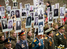 People participate in the action `Immortal regiment` at the celebration of Victory Day. Royalty Free Stock Photo
