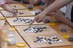 People participate in the go game. Alphago royalty free stock photos