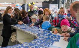 People participate in the information game in Europe Day in Tallinn. TALLINN,ESTONIA - MAY 1: Tallinn Old town on MAY 1,2014. People participate in the stock images