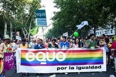 People participating on a demonstration at the Gay Pride parade in Madrid Stock Photos