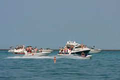 People Party On Boats Anchored In Lake Michigan Royalty Free Stock Image