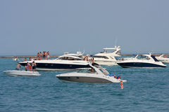 People Party On Boats Anchored On Lake Michigan stock images