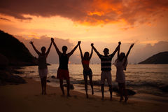 People partying on beach Stock Image