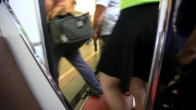 People pass through doors at the metro. HD. People pass through the glass doors at the metro stock video footage