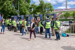 People pass through police frames metal detectors. Samara, Russia - June 2, 2018: People pass through police frames metal detectors at the city street in summer royalty free stock photos