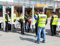 People pass through police frames metal detectors. Samara, Russia - May 1, 2018: People pass through police frames metal detectors at the city street in summer royalty free stock photos