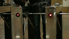 People pass through the turnstiles. Check point. Turnstiles in the subway stock video footage