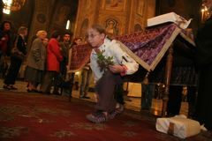 People pass under table in church for Easter tradition in Sofia, Bulgaria stock photography