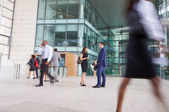 People passing through the busy foyer of a business building Royalty Free Stock Photography