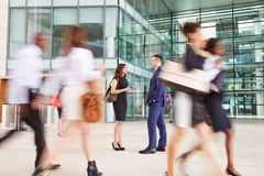 People passing through the busy foyer of a business building Stock Image