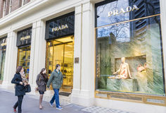 People passing by The Collins Street Prada store in Melbourne, Australia Royalty Free Stock Photos
