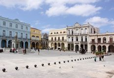 People passing by in plaza vieja, havana stock images