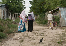 People passing by in Zanzibar village Royalty Free Stock Image