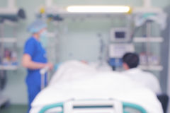People at the patient bed, unfocused background Stock Photos