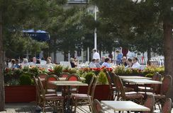 People at pavement restaurant. Gunwharf Quays. Portsmouth. UK Stock Image