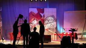 The people in the pavilion TV Studio . Shooting a television show.Silhouettes of workers and machinery of television stock video