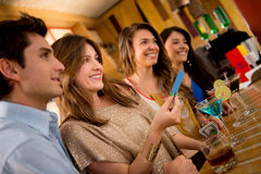 People paying for drinks at the bar Stock Images